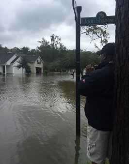 Arbor Oaks Resident looking over the flood