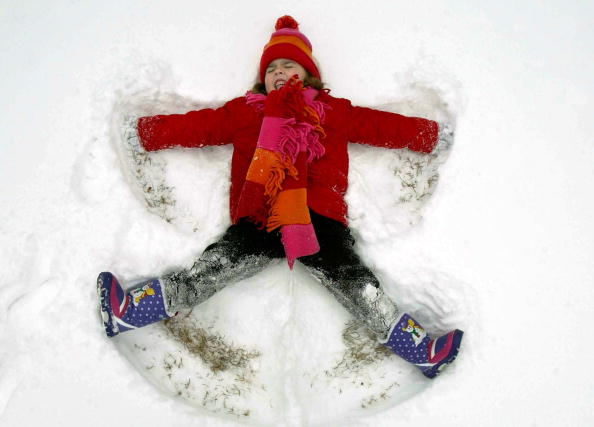 OWINGS, MD - JANUARY 26: Kyndra Hendrick makes a snow angel January 26, 2003 in Owings, Maryland. The Washington, DC area was hit with a winter storm last night leaving 4 to 6 inches of snow closing area schools.   (Photo by Mark Wilson/Getty Images)