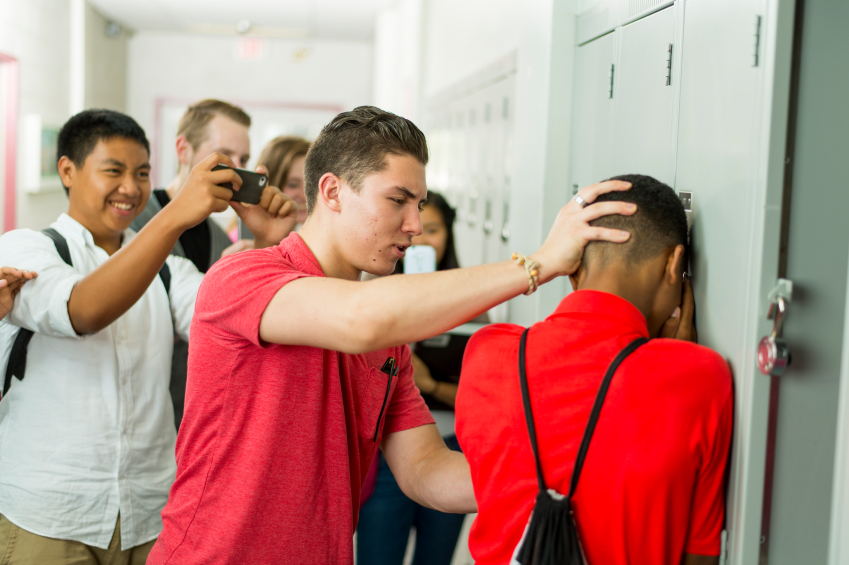 High school students being bullied. Site:http://www.aegis.com/bullying-in-school-is-a-leading-cause-of-active-shooters-school-violence/