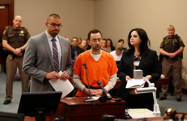 Larry Nassar in court listening to his sentencing being handed down by the judge