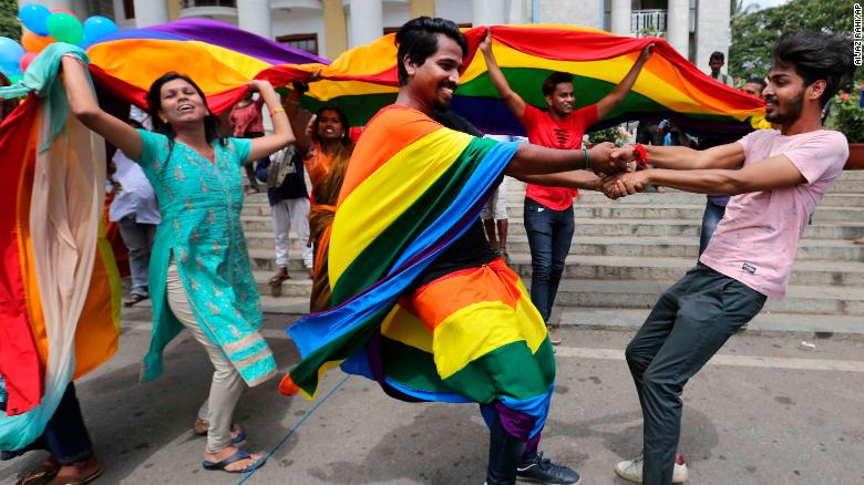 Members+of+the+LGBT+community+dance+to+celebrate+after+the+country%27s+top+court+struck+down+a+colonial-era+law+that+made+homosexual+acts+punishable+by+up+to+10+years+in+prison%2C+in+Bangalore%2C+India%2C+Thursday%2C+Sept.+6%2C+2018.+The+court+gave+its+ruling+Thursday+on+a+petition+filed+by+five+people+who+challenged+the+law%2C+saying+they+are+living+in+fear+of+being+harassed+and+prosecuted+by+police.+%28AP+Photo%2FAijaz+Rahi%29