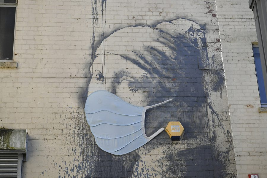 Coronavirus+-+Wed+Apr+22%2C+2020.+Banksy%27s+Girl+with+a+Pierced+Eardrum+mural+has+been+given+a+face+mask+in+a+nod+to+the+coronavirus+pandemic%2C+at+Hanover+Place+in+Bristol%2C+as+the+UK+continues+in+lockdown+to+help+curb+the+spread+of+the+coronavirus.+Picture+date%3A+Wednesday+April+22%2C+2020.+See+PA+story+HEALTH+Coronavirus.+Photo+credit+should+read%3A+Ben+Birchall%2FPA+Wire+URN%3A53501013+%28Press+Association+via+AP+Images%29