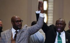 Philonise Floyd and Attorney Ben Crump, from left, react after a guilty verdict was announced at the trial of former Minneapolis police Officer Derek Chauvin for the 2020 death of George Floyd, Tuesday, April 20, 2021, in Minneapolis, Minn. Former Minneapolis police Officer Derek Chauvin has been convicted of murder and manslaughter in the death of Floyd. (AP Photo/Julio Cortez)