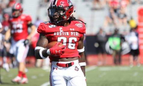 Austin Peay defensive back Juantarius Bryant (26) holds the ball after thinking he had an interception during the first half of the Govs